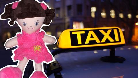 Puppe aus dem Taxi