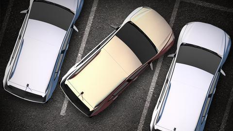 Drei Autos auf einem Parkplatz: Das mittlere steht total schief in der Parkbucht.