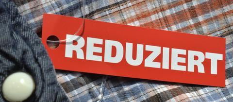 """Hemd mit den Hinweisschild """"Reduziert"""""""